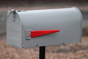gray and red mailbox